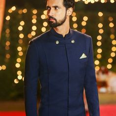 Royal, elegant and chic - a navy calf length sherwani to up the groom's style game at the Sangeet occasion. Keep it minimal just like Aalekh Kapoor did in the NDTV Good Times - Yaari Dosti Shaadi. Mens Wedding Wear Indian, Mens Indian Wear, Mens Ethnic Wear, Indian Groom Wear, Wedding Dress Men, Wedding Suits, Arab Men Fashion, African Men Fashion, Mens Fashion Suits