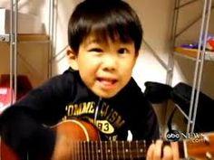 Cutie playing ukulele