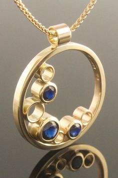 Recycled yellow gold and blue sapphire circle pendant