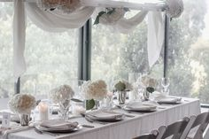 We created a beautiful wedding styling using only white hydrangeas, candles and linen. This created the perfect romantic style for a summer wedding reception. Wedding Shoot, Wedding Reception, Our Wedding, Dream Wedding, Large Candles, Pillar Candles, White Hydrangeas, Bridal Table, Romantic Look