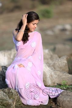 How soothing is the lavender color. Delicately decorated with fresh Lilac bunches made with our signature ribbonwork embroidery, this saree is a beautiful play with a very cool shade of lavender and the all hand-made exquisite embroidery. Here's a saree to invoke that feminine mystique in you. PRICE: INR 12,852.00; USD 189.00 To buy click here: https://www.eastandgrace.com/products/lilac For help reach us at care@eastandgrace.com. With love www.eastandgrace.com