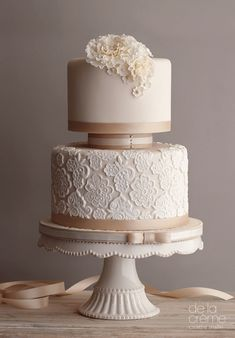 Lovely lace print wedding cake with simple ribbon detail.