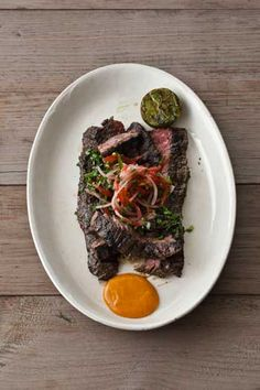 Bobby Flay's Cuban Skirt Steak with Tomato Escabeche and Mango Steak Sauce: A steak so aromatic, you can smell the garlic in the marinade the instant it hits the grill. And ripe mango puree flavors the savory steak sauce.