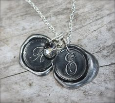 I really like this! Handmade wax seal initials on a necklace...so unique! Made by Okrrah.