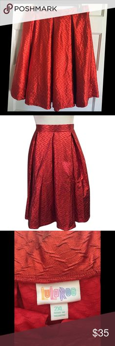 Lularoe Elegant Collection Madison skirt, 2X Who says you need ruby red SLIPPERS to find Kansas!? Why not slip on this ruby red Madison skirt instead? This is a Lularoe brand Madison skirt from the 2016 Elegant Collection. It is size 2X. It has been worn and washed only twice. It has pockets!! Sparkly metallic shimmer, and absolutely beautiful. Would look great with a black and white striped top. From smokefree home. Size chart is attached for your convenience along with model photos. Thanks…