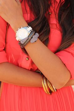 snake bracelet and coral top