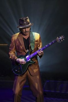 Carlos Santana.. One of the greatest guitar players in the world.. Another guitar god.