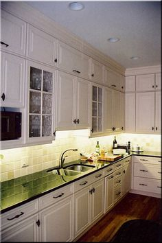 White cabinets with black granite, perfect for my kitchen.