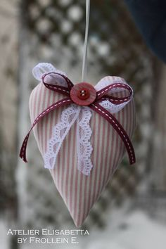 Pretty Heart made from fabric and adorned with bows