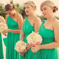 Emotional bridesmaids looking gorgeous in green at this exotic, beautiful beach wedding.