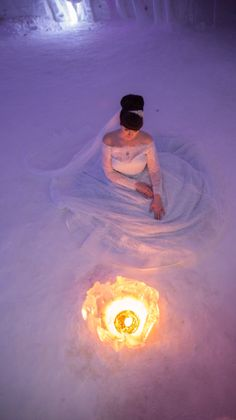 This image gives us a warm glow. Real Bride Amy at her Lapland wedding