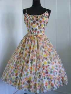 1950's summer dress...Before my time but I really like the style and Fabric Patter!! POKA DOTS!!