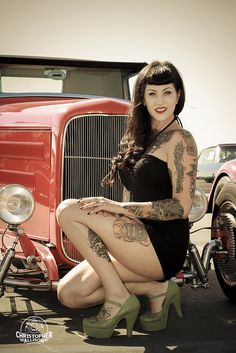 Pin Up Model Lauren Shade posing with red 32 Roadster from the LA Roadsters Car…