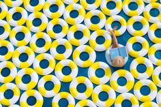 Pool and Rubber Rings Creative Photography by Gray Malin