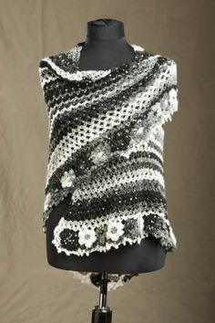 making this right now. I have this yarn in stock. It used to come only in shades of black n white, now there are colors!
