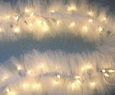 DIY tulle garland! Tie strips around strands of lights! LOVE! It would be so cute in Christmas colors on a mantle:)
