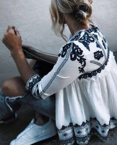 white and blue embroidered peasant top.