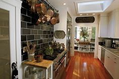 in love with the large, black subway tile backsplash... okay, in love with Tyler Florence's whole kitchen.