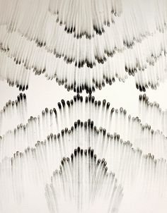 NYC artist Judith Braun creates enormous symmetrical wall paintings using nothing but black paint and her fingers.