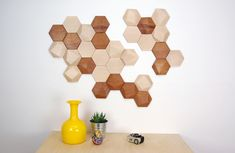 Monoculo Design Studio's Bee Apis unique faceted wood tiles allow you to create any kind of composition you want on your wall with their geometric shapes.