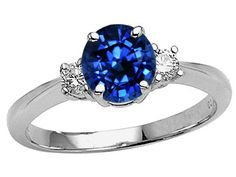 Saphire engagement ring...I love the idea of an engagement ring whose main stone isn't a diamond.