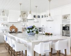 Florida Beach Cottage Kitchen Design elements French wide plank white oak flooring, white marble countertops, white cabinets, shiplap walls, open shelving and an oversized kitchen island Beach Cottage Kitchens, Coastal Cottage, Coastal Living, Home Kitchens, Modern Coastal, White Coastal Kitchen, Coastal Kitchens, Florida Living, Coastal Farmhouse