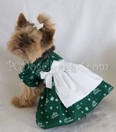 - Beautiful Dress for Christmas - Pretty white colored attached apron - White ribbon and bow at waist - It easily attaches with adjustable velcro neck and belly straps - Open chest design