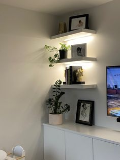 LED lit floating shelves in the media room add a touch of luxury to the space. Polished Concrete, Shelf Design, Showcase Design, Concrete Floors, Hand Blown Glass, Floating Shelves, Luxury Homes, New Homes, Touch