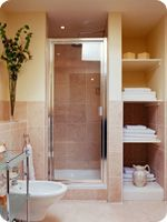 A small, efficient, appealing  3/4 bathroom.