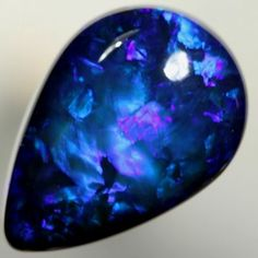 Black Opal | Blue Harlequin pattern | Lightning Ridge, Australia ~ this is incredibly beautiful ♥