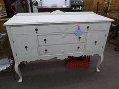 $329 - Long legged buffet with 1 drawer - 2 short drawers & 2 cabinets for storage - dovetail mahogany construction - painted creamy white, distressed and finished in a tinted wax. ***** In Booth C5 at Main Street Antique Mall 7260 E Main St (east of Power RD on MAIN STREET) Mesa Az 85207 **** Open 7 days a week 10:00AM-5:30PM **** Call for more information 480 924 1122 **** We Accept cash, debit, VISA, Mastercard, Discover or American Express