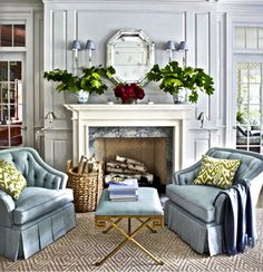 Am repinning this b/c previous pinner has answered my question re wall color. Thought Color over mantle was an icy blue & have gone to great liengths s to find the color. I now know it is gray wood panelling. Thanks to this Pinner!