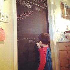 I always have a kiddo at my feed while I try to get dinner ready.  I turned the door in my kitchen into a chalkboard.  It keeps them occupied and gets their creative juices flowing!