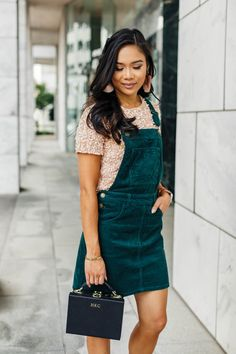 aee8528e3a Hoang-Kim wears a green corduroy overall dress with a blush sequin t-shirt