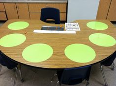 The green spots on the table function as dry erase boards for students to use during small group activities! This would be great for small group math activities when children are asked to represent their solution to a problem!