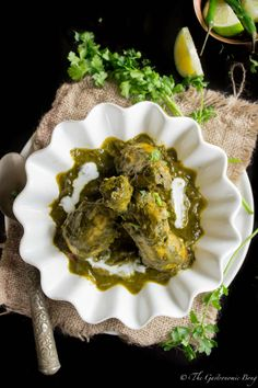Murg Saagwala: North India chicken  cooked in a mildly spiced and smooth spinach curry.
