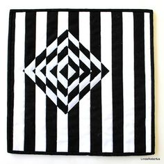 Linda Robertus: SAQA Oceania Blog Hop All of these quilts are made in the same way: the background is pieced by sewing strips of black and white fabric together. More strips are sewn together and from this fabric pieces are cut and appliquéd to the background with a satin stitch: