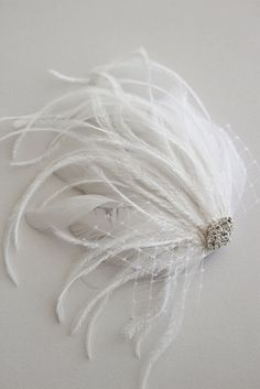 SCARLETT - bridal feather fascinator, wedding headpiece, feather hair clip. $90.00, via Etsy.