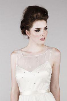 Saja high-neckline wedding dress: http://www.stylemepretty.com/2014/10/29/12-high-neckline-dresses-that-are-absolutely-stunning/