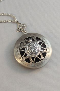 I have created this beautiful Apothecary Scent Locket using a lovely antiqued silver locket, with pretty cut outs in the center. I have added a pretty antiqued and beautiful Victorian turtle to the front of the locket. The locket is attached to the chain with a small Victorian