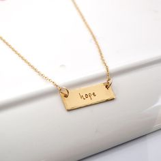 Hand Stamped Bar One Word Necklace in NuGold by DesignMeJewelry on Etsy
