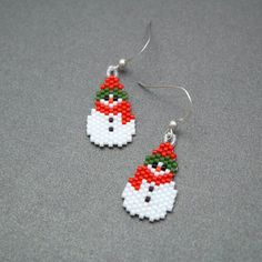 Sweet little snowman earrings, great for gift giving, or for yourself! Each beaded snowman measures 1 3/4 inches long by 1/2 inch wide. That includes measuring from the top of the ear wire to the bott