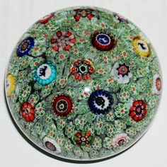 """Green """"Carpet Ground"""" glass paperweight by the Compagnie des Verreries et Cristalleries de Baccarat, 1848. Corning Museum of Glass."""