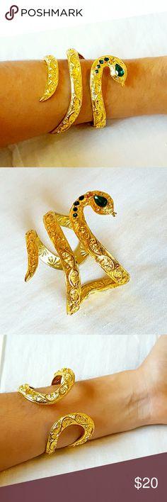 Gold bracelet | Rachel Zoe Snake design bracelet with green jewels. One jewel missing (shown in second photo). Adjustable size. Rachel Zoe Jewelry Bracelets