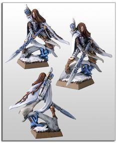 The blue and brown is pretty and interesting. Sort of a wintery forest.  Cyric's Wood Elf Army.