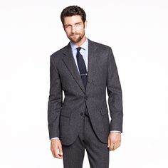 The foundation to any man's wardrobe is a great fitting suit. This is an investment. This suit has a modern, slimmer fit and comes in a super chic heather grey.