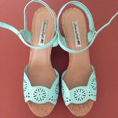 Teal Floral Laser Cut Wedges Perfect for spring and summer! The color is much more vibrant than in the photos. The heel is 4.25in and the platform is 1.25in, so it feel like you're walking in a 3in heel. I only wore these once or twice! American Eagle by Payless Shoes Platforms