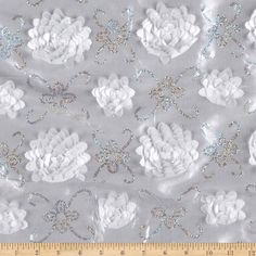 Stunning Sequined Rosette Satin White from @fabricdotcom  This fabulous fabric features embroidered faceted sequin vines and elegant satin rosettes sewn to lightweight satin fabric. Voluminous and dimensional, this fabric is perfect for special occasion dresses, skirts, petticoats, overlays, costumes and even table top decor.