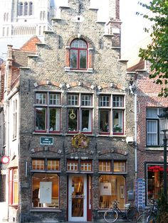 A piece of style that attracts me to architecture in the first time: Print shop, Bruges, Belguim