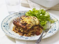 This popular Turkish dish features layers of tender eggplant, tomato sauce and seasoned ground beef topped with an optional white sauce and cheese.
